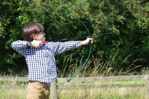 boy practicing archery